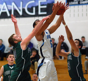Ralston Valley senior Zac Stevens, middle, goes up for a shot as Pine Creek seniors Derek Keirns, left, and Joey Black knocks the ball loose Wednesday night in the opening round of the Class 5A boys basketball state tournament. (Dennis Pleuss)