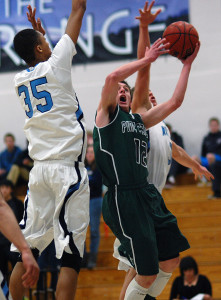 Pine Creek senior Grant Morin (12) is challenge in the air by Ralston Valley sophomore Dallas Walton (35) and senior Bryn Finnefrock during the second half Wednesday night in the opening round of the Class 5A state tournament.