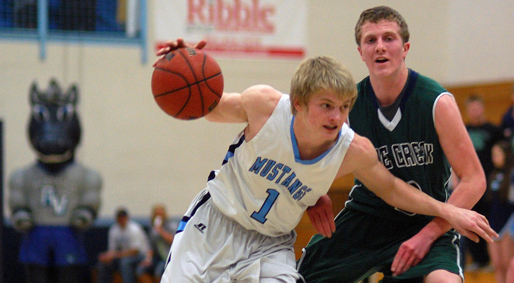 Ralston Valley junior Andrew Wingard (1) drives past Pine Creek junior Jared Savage during the first half Wednesday night. Wingard finished with 14 points in the Mustangs' 72-54 victory. (Dennis Pleuss)